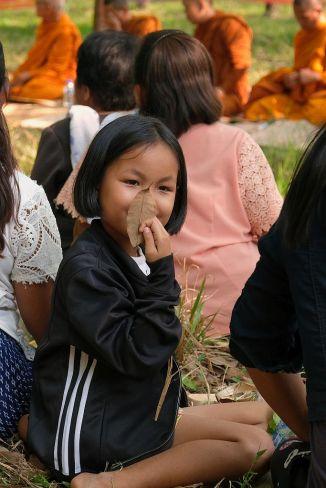 Girl hidingbehind a leaf